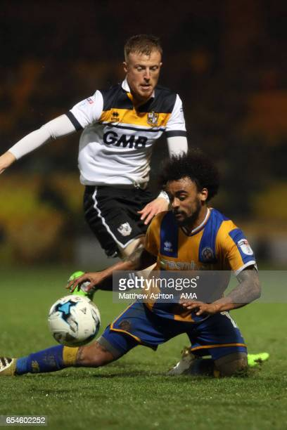 Ryan Taylor of Port Vale and Junior Brown of Shrewsbury Town during the Sky Bet League One match between Port Vale and Shrewsbury Town at Vale Park...