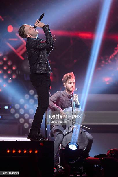 Ryan Tedder and Brent Kutzle of OneRepublic perform on stage at Barclaycard Center on November 20 2014 in Madrid Spain