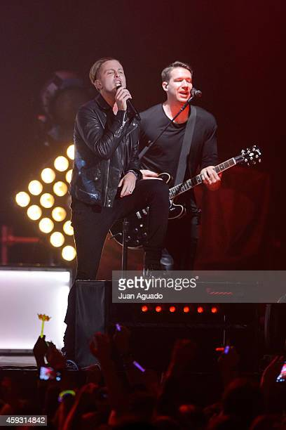 Ryan Tedder and Zach Filkins of OneRepublic performs on stage at Barclaycard Center on November 20 2014 in Madrid Spain