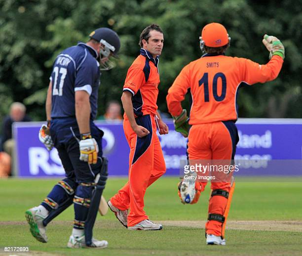 Ryan Ten Doeschate and J Smits of the Netherlands celebrate after bowling out Ryan Watson of Scotland during the Netherlands v Scotland ICC World...