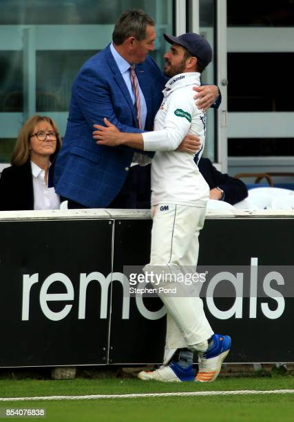 Ryan ten Doeschate of Essex greets former player Graham Gooch during day two of the Specsavers County Championship Division One match between Essex...