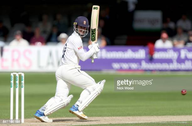 Ryan ten Doeschate of Essex guides the ball for four runs during the Essex v Somerset Specsavers County Championship Division One cricket match at...
