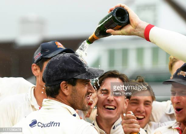 Ryan Ten Doeschate of Essex has champagne poured on his head after winning the County Championship during Day Four of the Specsavers County...