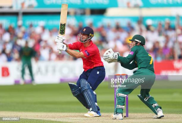 Ryan ten Doeschate of Essex hits out watched by Chris Read of Nottinghamshire during the Royal London OneDay Cup Semi Final between Essex and...