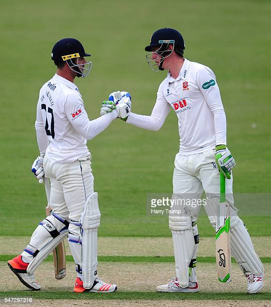 Ryan Ten Doeschate of Essex is congratulated by Dan Lawrence of Essex after reaching his half century during Day Two of the Specsavers County...