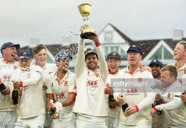 Ryan Ten Doeschate of Essex lifts the County Championship Trophy during Day Four of the Specsavers County Championship Division One match between...