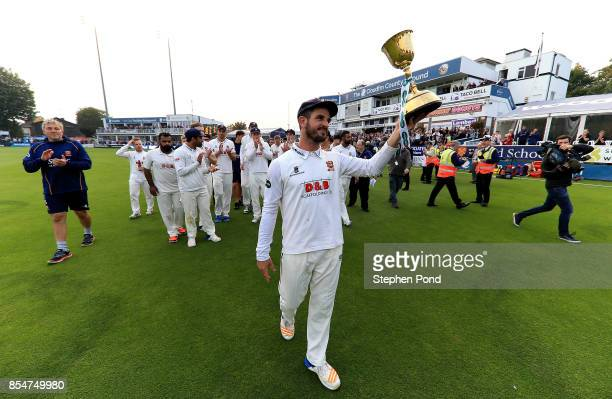 Ryan ten Doeschate of Essex lifts the County Championship trophy during day three of the Specsavers County Championship Division One match between...
