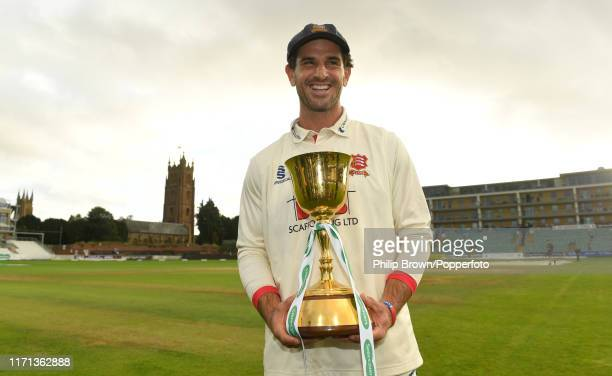 Ryan ten Doeschate with the trophy after Essex won the County Championship title after a draw in the County Championship Division One match between...