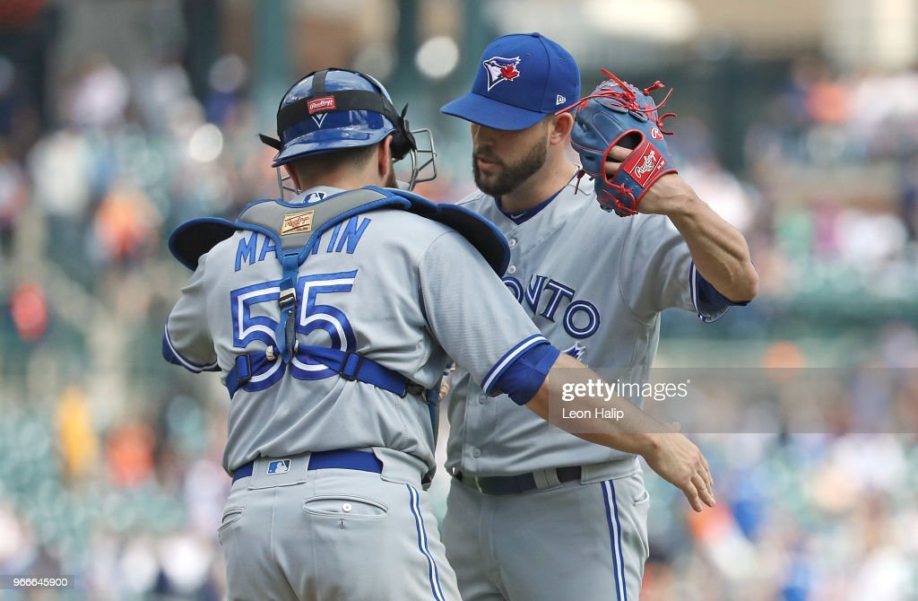 Ryan Tepera #52 and Russell Martin #55 of the Toronto Blue Jays celebrate a win over the Detroit Tigers at Comerica Park on June 3, 2018 in Detroit, Michigan. Toronto defeated Detroit 8-4.