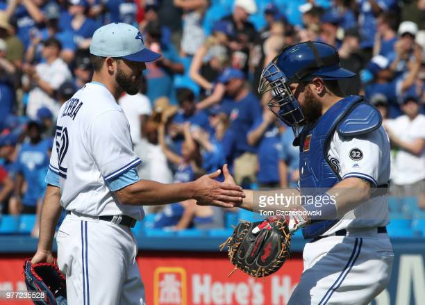 Ryan Tepera of the Toronto Blue Jays celebrates a victory with Russell Martin over the Washington Nationals at Rogers Centre on June 17 2018 in...