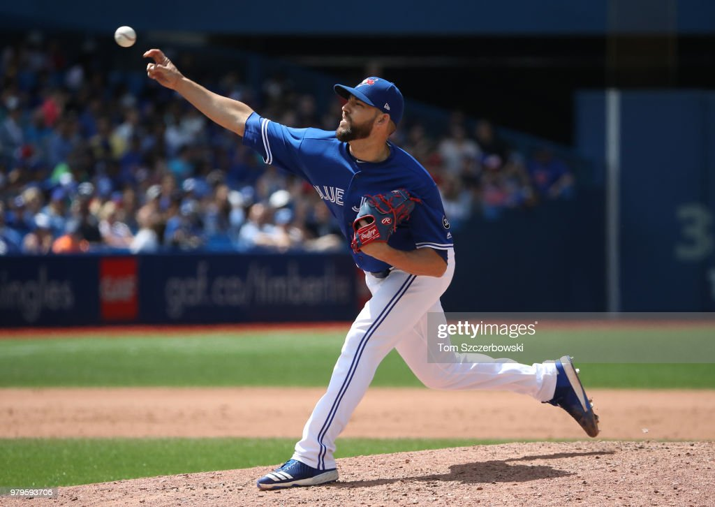 Ryan Tepera #52 of the Toronto Blue Jays delivers a pitch in the ninth inning during MLB game action against the Atlanta Braves at Rogers Centre on June 20, 2018 in Toronto, Canada.