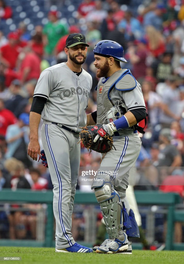 Ryan Tepera #52 of the Toronto Blue Jays is congratulated by Russell Martin #55 after saving a game against the Philadelphia Phillies at Citizens Bank Park on May 27, 2018 in Philadelphia, Pennsylvania. The Blue Jays won 5-3.