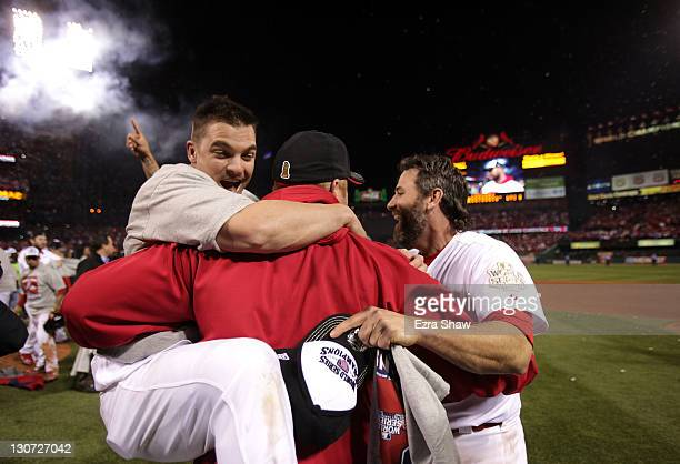 Ryan Theriot and Lance Berkman of the St Louis Cardinals celebrate after defeating the Texas Rangers 62 to win Game Seven of the MLB World Series at...