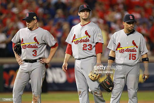 Ryan Theriot David Freese and Rafael Furcal of the St Louis Cardinals stand on the field during Game Three of the MLB World Series against the Texas...