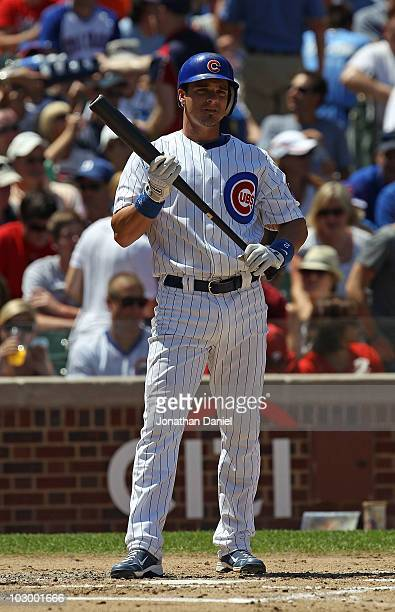Ryan Theriot of the Chicago Cubs prepares to bat against the Philadelphia Phillies at Wrigley Field on July 16 2010 in Chicago Illinois The Cubs...