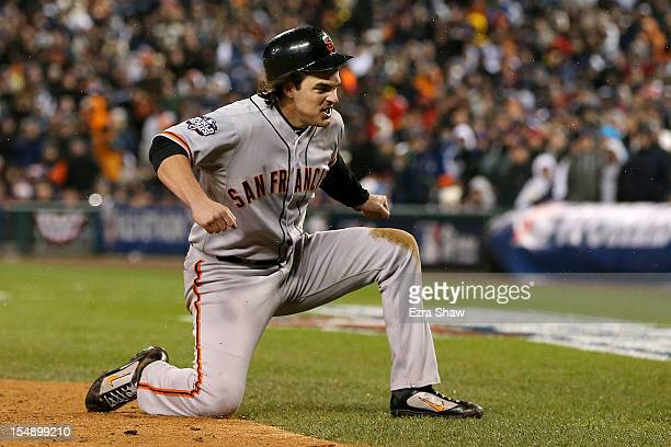 Ryan Theriot of the San Francisco Giants celebrates after scoring a run off of Marco Scutaro RBI single against Phil Coke of the Detroit Tigers in...