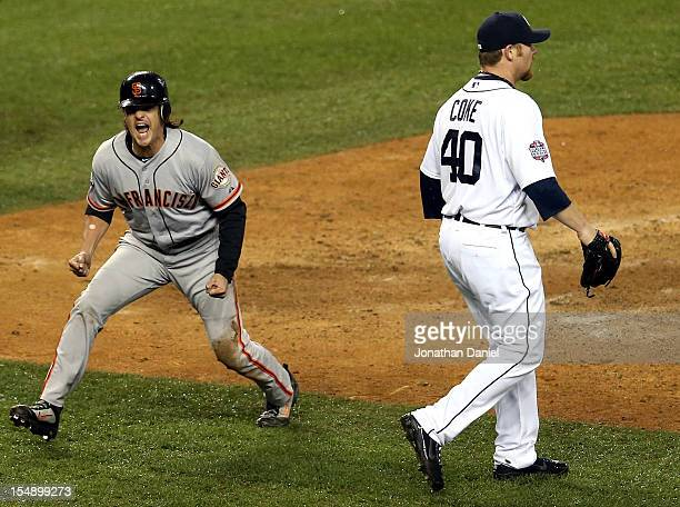 Ryan Theriot of the San Francisco Giants celebrates after scoring a run off of Marco Scutaro's RBI single against Phil Coke of the Detroit Tigers in...