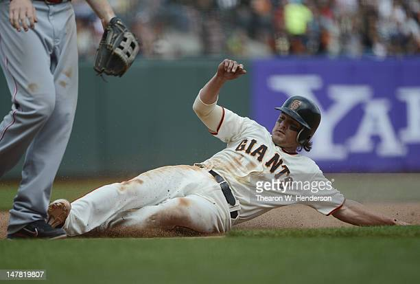 Ryan Theriot of the San Francisco Giants goes to third base on a pitch in the dirt in the seventh inning against the Cincinnati Reds at ATT Park on...