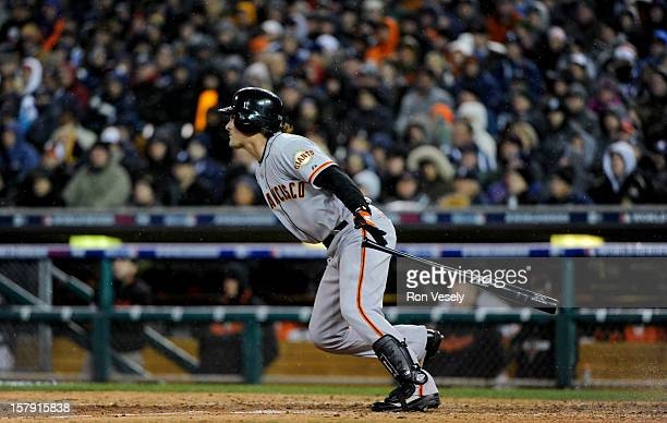 Ryan Theriot of the San Francisco Giants singles to lead off the top of the 10th inning during Game 4 of the 2012 World Series against the Detroit...