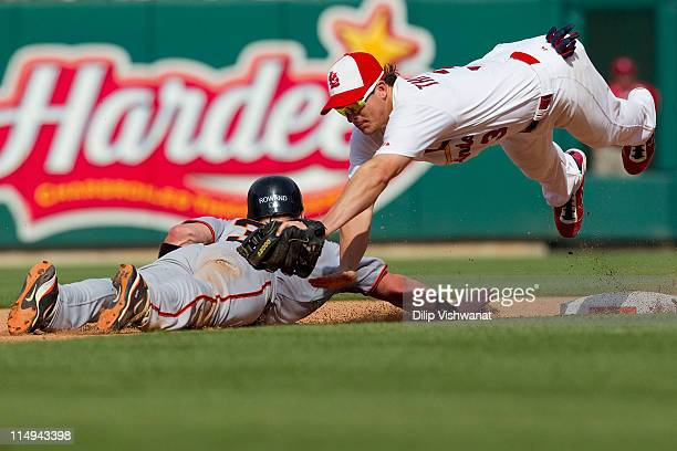 Ryan Theriot of the St Louis Cardinals attempts to pick off Aaron Rowand of the San Francisco Giants at second base at Busch Stadium on May 30 2011...