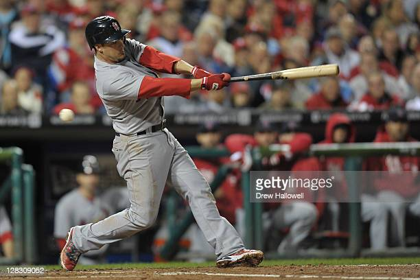 Ryan Theriot of the St Louis Cardinals bats during Game Two of the National League Division Series against the Philadelphia Phillies at Citizens Bank...