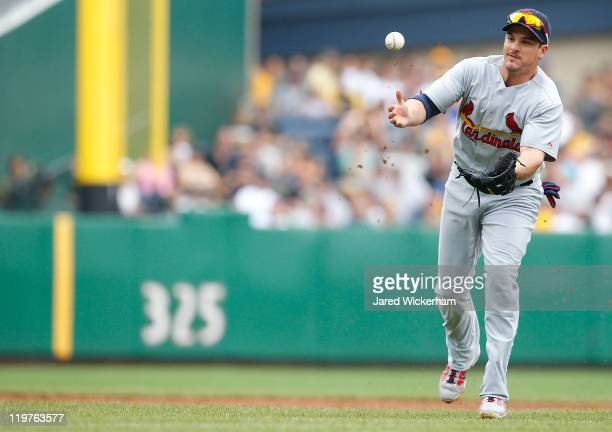Ryan Theriot of the St Louis Cardinals misplays a ground ball in the infield against the Pittsburgh Pirates during the game on July 24 2011 at PNC...