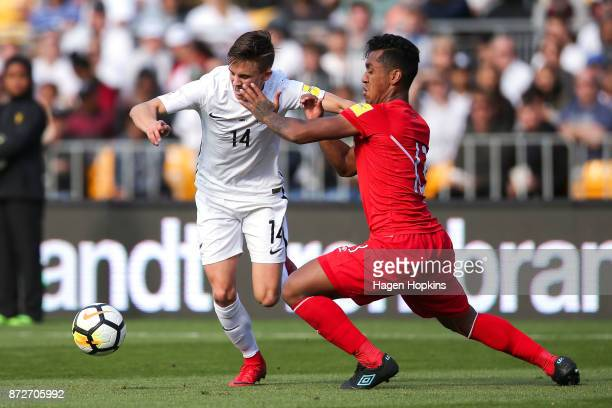 Ryan Thomas of New Zealand attempts to evade Renato Tapia of Peru during the 2018 FIFA World Cup Qualifier match between the New Zealand All Whites...