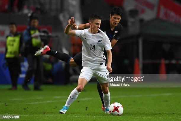 Ryan Thomas of New Zealand controls the ball under pressure of Hiroki Sakai of Japan during the international friendly match between Japan and New...