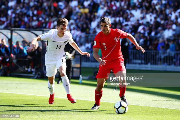 Ryan Thomas of the All Whites chases down Aldo Corzo of Peru during the 2018 FIFA World Cup Qualifier match between the New Zealand All Whites and...