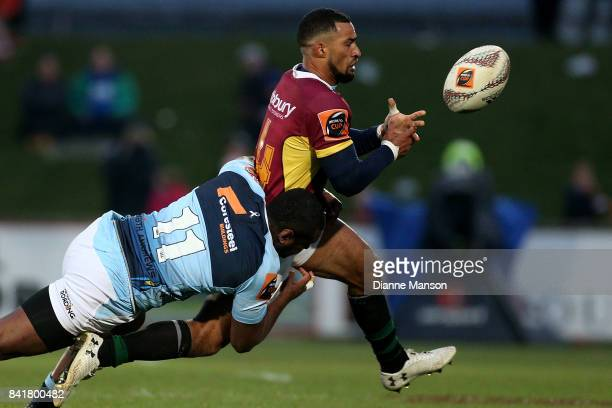 Ryan Tongia of Southland loses the ball when tackled by Jone Macilai of Northland during the round three Mitre 10 Cup match between Southland and...
