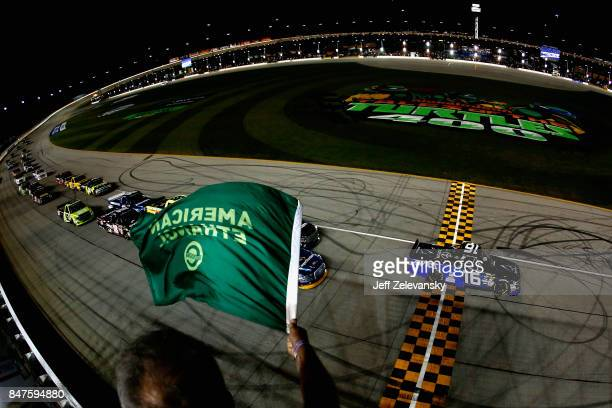 Ryan Truex driver of the ADVICS/AISIN Toyota leads the field to the green flag to start the NASCAR Camping World Truck Series TheHousecom 225 at...