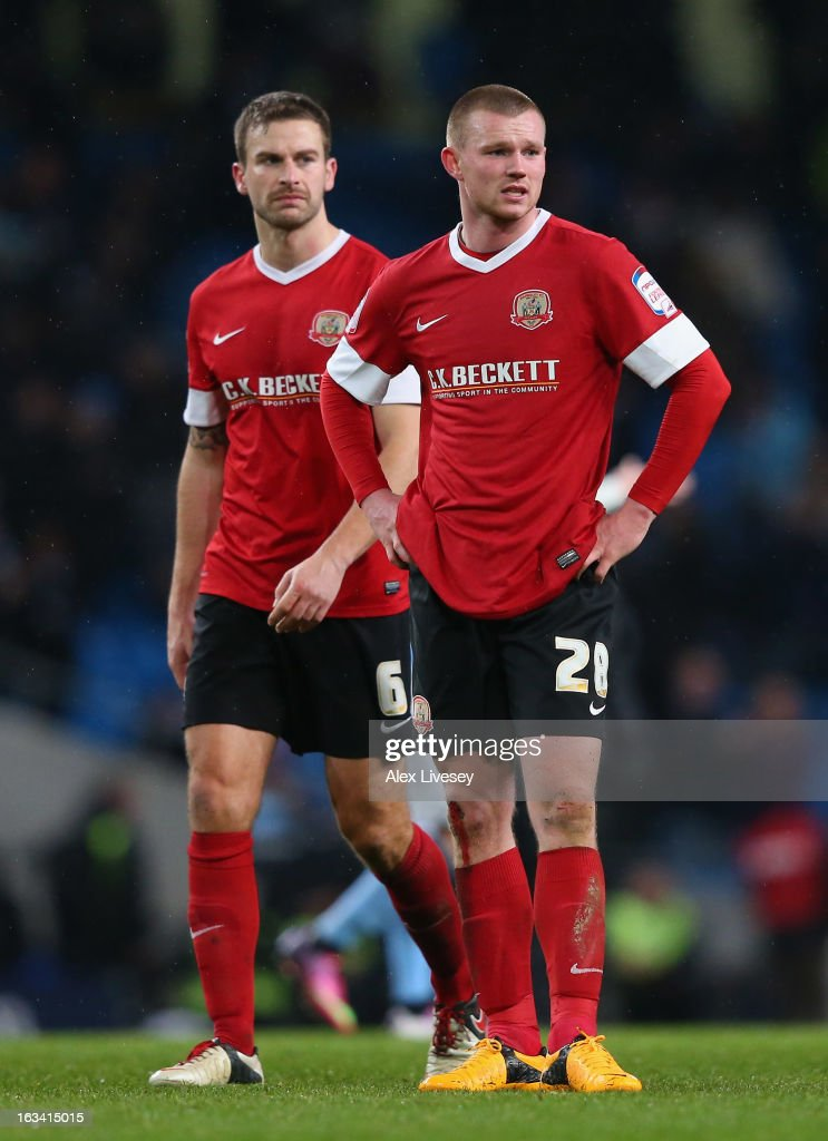 Ryan Tunnicliffe and Stephen Foster of Barnsley look dejected at the final whistle after the FA Cup sponsored by Budweiser sixth round match between Manchester City and Barnsley at Etihad Stadium on March 9, 2013 in Manchester, England.