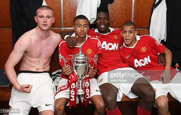 Ryan Tunnicliffe Jesse Lingard Paul Pogba and Ravel Morrison of Manchester United Academy Under18s celebrate with the FA Youth Cup trophy in the...