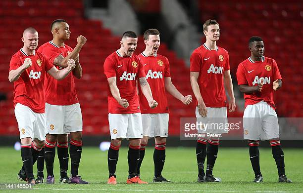 Ryan Tunnicliffe Joshua King Robert Brady Marnick Vermijl William Keane and Larnell Cole of Manchester United Reserves celebrate during the penalty...