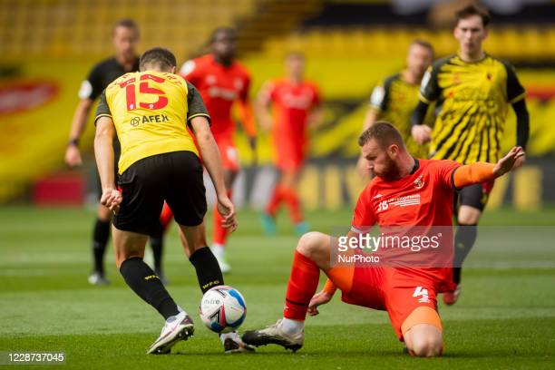Ryan Tunnicliffe of Luton Town ad Craig Cathcart of Watford during the Sky Bet Championship match between Watford and Luton Town at Vicarage Road...