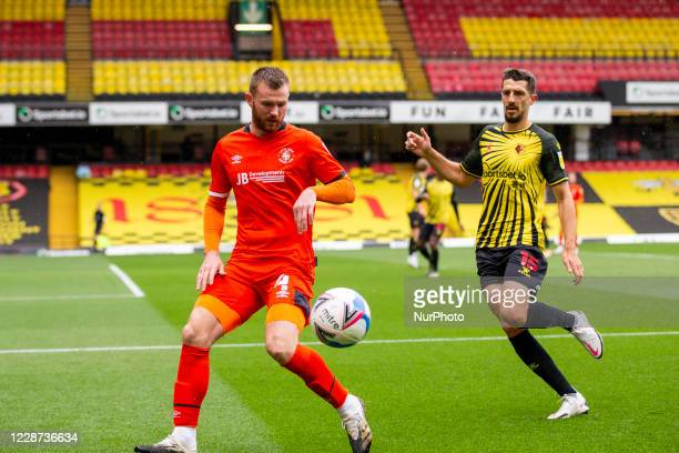 Ryan Tunnicliffe of Luton Town and Craig Cathcart of Watford during the Sky Bet Championship match between Watford and Luton Town at Vicarage Road...