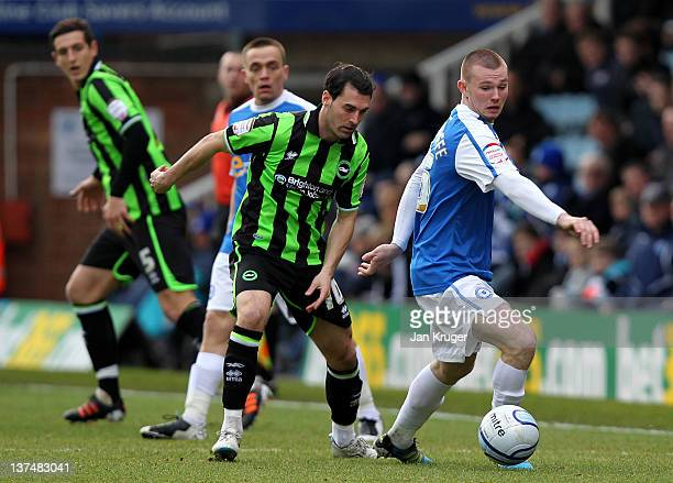 Ryan Tunnicliffe of Peterborough shields the ball from Matthew Sparrow of Brighton during the npower Championship match between Peterborough United...