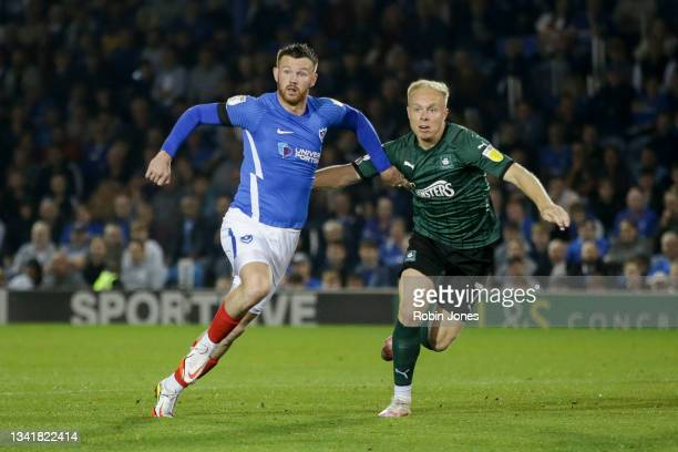 Ryan Tunnicliffe of Portsmouth FC and Ryan Broom of Plymouth Argyle race for the ball during the Sky Bet League One match between Portsmouth and...
