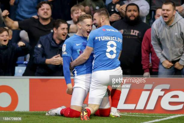 Ryan Tunnicliffe of Portsmouth FC celebrates with team-mate Ronan Curtis after he scores a goal to make it 1-0 during the Sky Bet Championship match...
