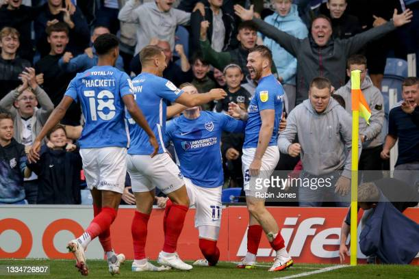 Ryan Tunnicliffe of Portsmouth FC celebrates with team-mates Recco Hackett-Fairchild, Lee Brown and Ronan Curtis after he scores a goal to make it...