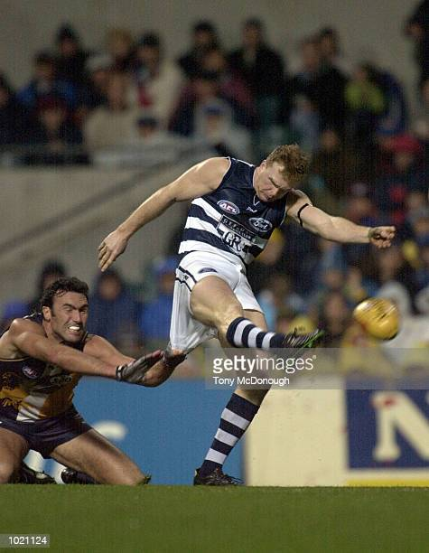 Ryan Turnbull for West Coast rips the shorts off Glen Kilpatrick for Geelong in the match between the West Coast Eagles and the Geelong Cats during...