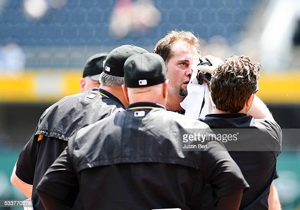 Ryan Vogelsong of the Pittsburgh Pirates is looked at by the Pirates staff after being hit in the head by a pitch thrown by Jordan Lyles of the...
