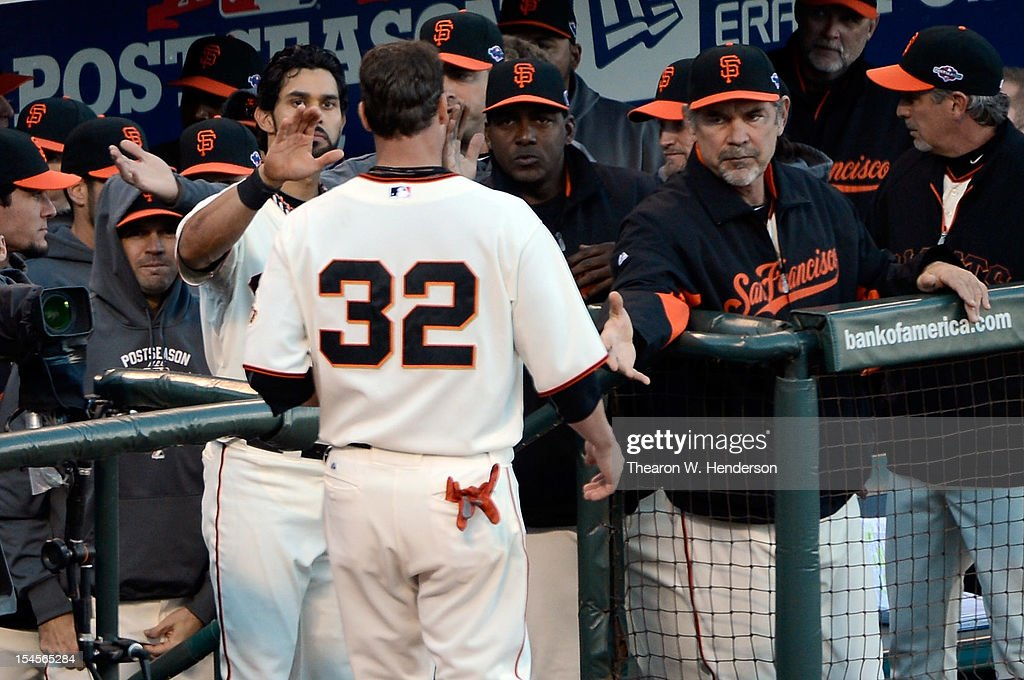 Ryan Vogelsong #32 of the San Francisco Giants is greeted at the dugout steps by manager Bruce Bochy #15 as the Giants take on the St. Louis Cardinals in Game Six of the National League Championship Series at AT&T Park on October 21, 2012 in San Francisco, California.