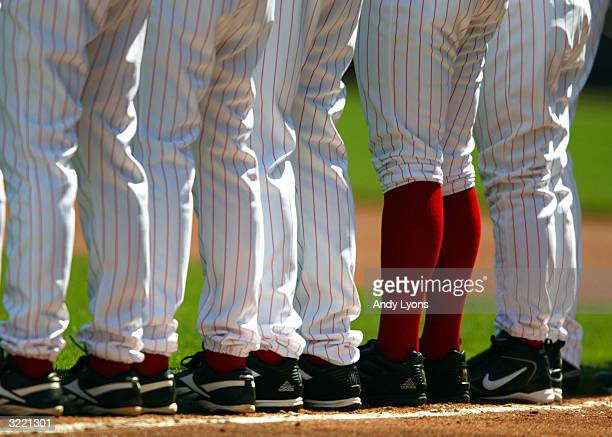 Ryan Wagner of the Cincinnati Reds has his pants pulled up while the rest of his team has theirs pulled down during introductions before the National...