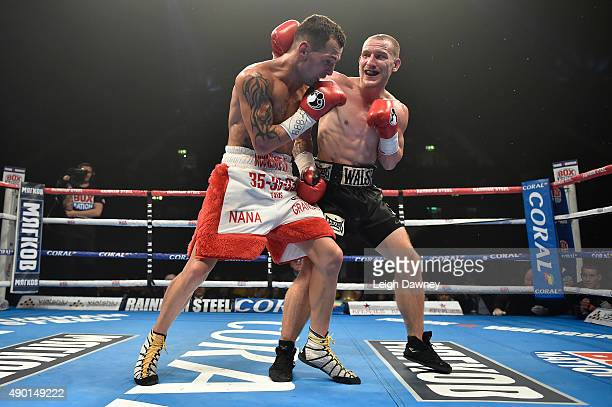 Ryan Walsh lands a right hand punch to the back of Samir Mouneimne's head during their vacant British featherweight title bout at the SSE Arena...
