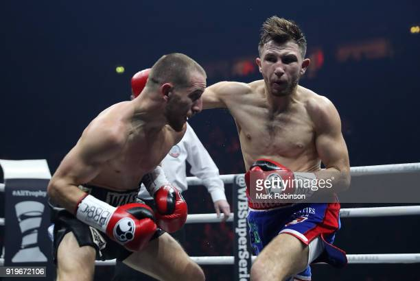 Ryan Walsh of Great Britain and Isaac Lowe of Great Britain exchange blows during their British Featherweight title bout at the Manchester Arena on...