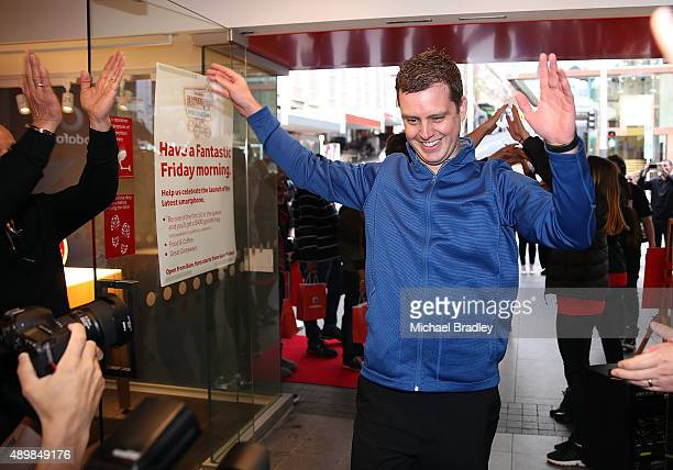Ryan Watkinson who was the first Vodafone customer in the world to get his iPhone 6s enters the Vodafone Queen Street store on September 25 2015 in...