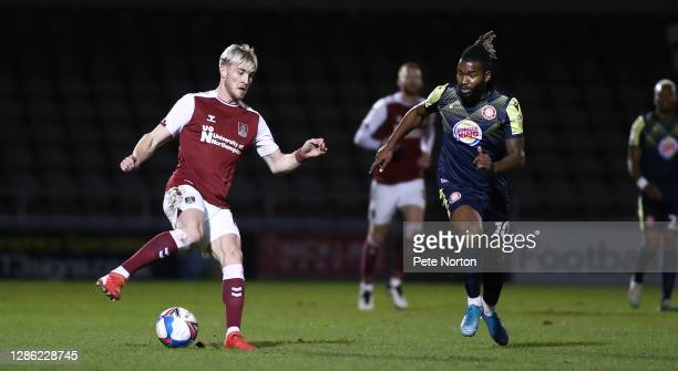 Ryan Watson of Northampton Town controls the ball watched by Tyrone Marsh of Stevenage during the Papa John's Trophy match between Northampton Town...