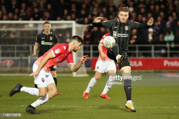 Ryan Watson of Northampton Town FC battles for possession with Cameron Burgess of Salford City FC during the Sky Bet League 2 match between Salford...