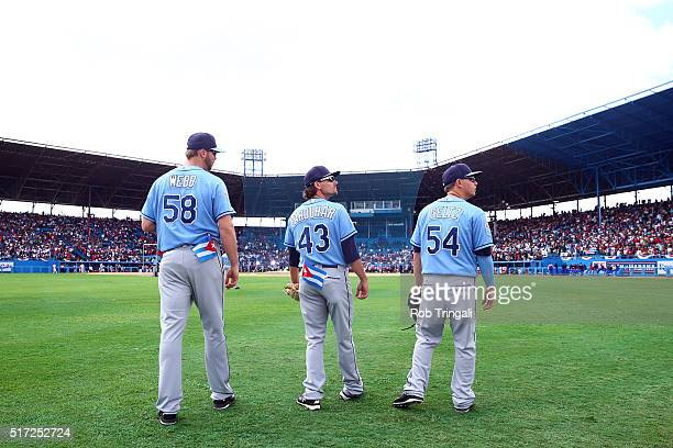 Ryan Webb Danny Farquhar and Steve Geltz of the Tampa Bay Rays are seen in the outfield before the game against the Cuban National team at Estadio...